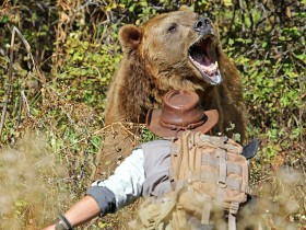 Adam plays the role of a bear that feels threatened and approaches a human.