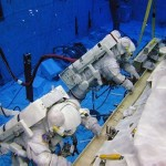 Spacewalking is truly a one-of-a-kind gig. But just like many other jobs, there's lots of practice involved. Training for spacewalks is intensive. Here we see astronauts preparing for spacewalking by practicing their tasks underwater, in a giant pool NASA calls the Neutral Buoyancy Laboratory. Image Credit: NASA