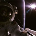 In low-Earth orbit, the atmosphere is so thin that there isn't enough of it to scatter and diffuse sunlight. So what you get up there are black shadows and dark sky, even when the sun is shining. You can see that effect in this 1997 picture as astronaut John Tanner does a spacewalk to perform some service work on the Hubble Space Telescope. If you look closely, you can see a checklist attached to Tanner's left arm. Image Credit: NASA