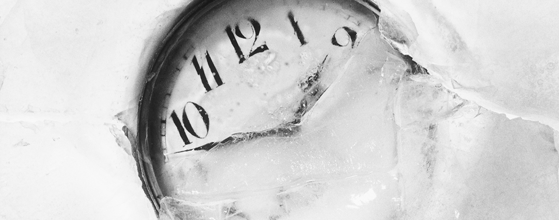 Pocket watch embedded in ice