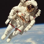 Imagine being out in space, untethered to anything...sound pretty cool? Actually, most spacewalks keep astronauts tethered to the ship. Image Credit: PhotoLink/Getty Images