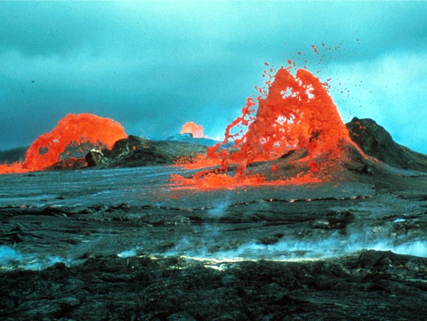 Orange fountains of molten lava boil from these vents on the black sea of rock at the Mauna Ulu eruption. This photo was captured on the afternoon of Oct. 15, 1970. Image Credit: D.W. Peterson/USGS